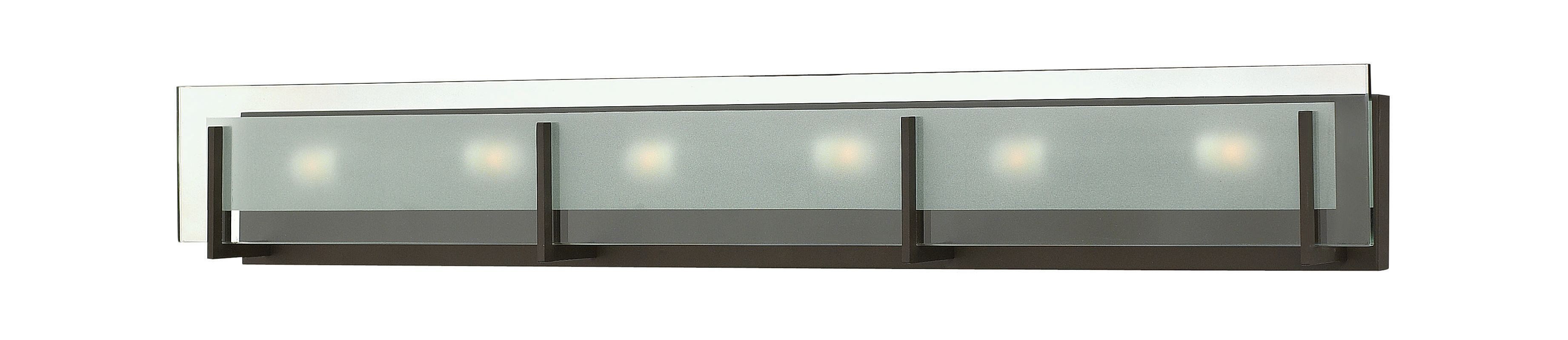 """Hinkley Lighting 5656-LED 6 Light ADA Compliant LED Bath Bar from the Sale $679.00 ITEM#: 2635600 MODEL# :5656OZ-LED UPC#: 640665565676 Six Light ADA Compliant LED Bath Bar from the Latitude Collection Features: Clear Beveled Inside-Etched glass rectangle shade Etched glass shades offer creative patterns and designs Made of steel Designed to cast a soft ambient light over a wide area Can be mounted facing upwards only Energy efficient ADA Compliant Suitable for damp locations Lamping Technology: LED - Light Emitting Diode: Highly efficient diodes produce little heat and have an extremely long lifespan. Specifications: Backplate Height: 4.75"""" Backplate Width: 36.25"""" Bulb Included: Yes Bulb Type: LED Extension: 4"""" (measured from mounting surface to furthest protruding point on fixture) Full Backplate: Yes HCO: 3.25"""" (height from center of outlet) Height: 5.75"""" LED: Yes Material: Steel Number of Bulbs: 6 Product Weight: 14 lbs Shade Height: 4.75"""" Shade Width: 18"""" Sloped Ceiling Compatible: No Title 24: No UL Rating: Damp Location Voltage: 120v Wattage: 39.6 Watts Per Bulb: 6.6 Compliance: UL Listed - Indicates whether a product meets standards and compliance guidelines set by Underwriters Laboratories. This listing determines what types of rooms or environments a product can be used in safely. ADA Compliance - The Americans with Disabilities Act (ADA). Fixtures hung between 27"""" and 80"""" above the floor must have an extension of 4"""" or less; this applies to wall lights hung in walkways, halls, corridors, passageways or aisles. Ceiling Fixtures must be hung no lower than 80"""". About Hinkley Lighting: Since 1922, Hinkley Lighting has been driven by a passion to blend design and function in creating quality products that enhance your life. Hinkley is continually recommended by interior and exterior designers, and is available to you through premier lighting showrooms across the country. They pride themselves in delivering superior customer service that is second to none. They"""