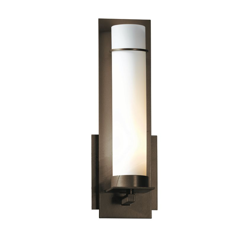 """Hubbardton Forge 204260 1 Light Wall Sconce from the New Town Sale $424.60 ITEM#: 1164000 MODEL# :204260-05 Features: All Hubbardton Forge products are made to order in Castleton, Vermont USA Ultra secure mounting assembly ensures a sturdy installation Sends light in an upward direction as well as providing a general ambient light for your room Hand made nature of this product makes no two fixtures identicalLamping Technology: Bulb Base - Candelabra (E12): The E12 (Edison 12mm), Candelabra Edison Screw (CES), """"Candelabra"""" is a term for the small-based incandescent light bulbs used in luminaires made for lighting and decoration. Compatible Bulb Types: Nearly all bulb types can be found for the E12 Candelabra Base, options include Incandescent, Fluorescent, LED, Halogen, and Xenon / Krypton.Specifications: Number of Bulbs: 1 Bulb Base: Candelabra (E12) Bulb Type: Compact Fluorescent Watts Per Bulb: 60 Wattage: 60 Height: 12.6"""" Width: 4.25"""" Depth: 3.7"""" Extension: 3.7"""" ADA: Yes UL Listed: Yes UL Rating: Damp LocationCompliance: ADA Compliance - The Americans with Disabilities Act (ADA). Fixtures hung between 27"""" and 80"""" above the floor must have an extension of 4"""" or less; this applies to wall lights hung in walkways, halls, corridors, passageways or aisles. Ceiling Fixtures must be hung no lower than 80"""". UL Listed - Indicates whether a product meets standards and compliance guidelines set by Underwriters Laboratories. This listing determines what types of rooms or environments a product can be used in safely.Warranty: All Hubbardton Forge products come with a limited lifetime warranty on finish and electrical components. This includes products used outdoors and near the coast. Read more about the Hubbardton Forge warranty below. Celebrating 40 years in business, Hubbardton Forge has been serving their customers by manufacturing unique pieces of lighting for years. Steadfastly committed to designing, manufacturing, and creating lighting under one roof in Vermont, you'l"""